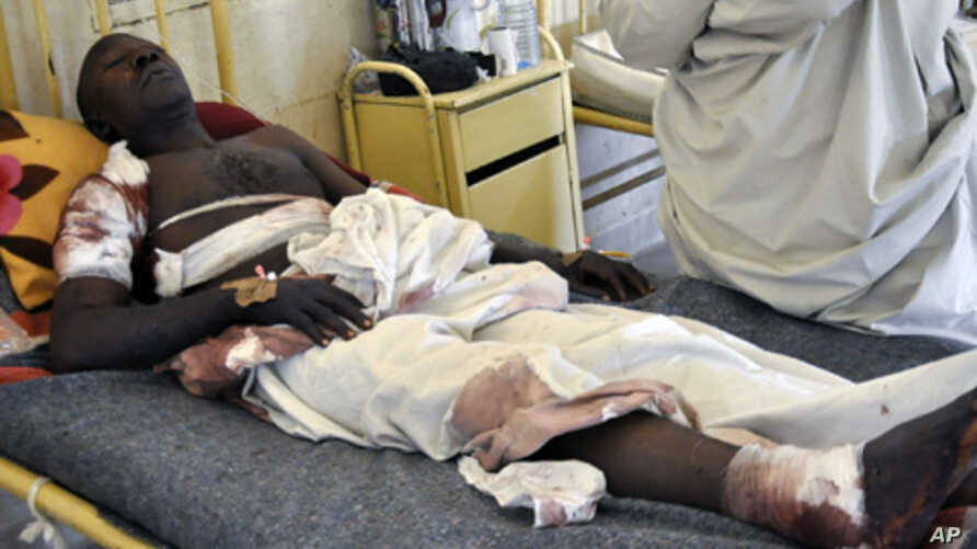 A survivor of a bomb attack rests at a hospital bed in Nigeria's northern city of Kano January 21, 2012.