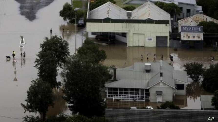 People wade through floodwaters in the town of Moree, Northern New South Wales, Australia, February 3, 2012.