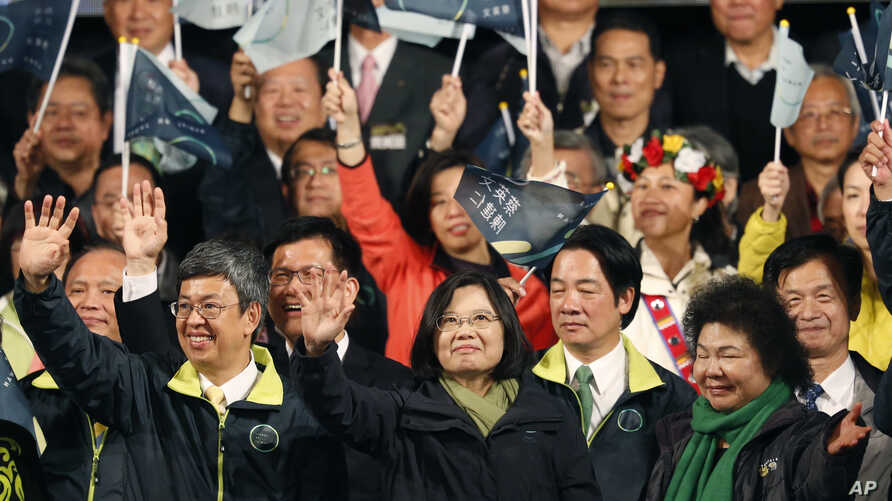 Taiwan's Democratic Progressive Party, DPP, presidential candidate, Tsai Ing-wen, waves as she declares victory in the presidential election in Taipei, Taiwan, Jan. 16, 2016.