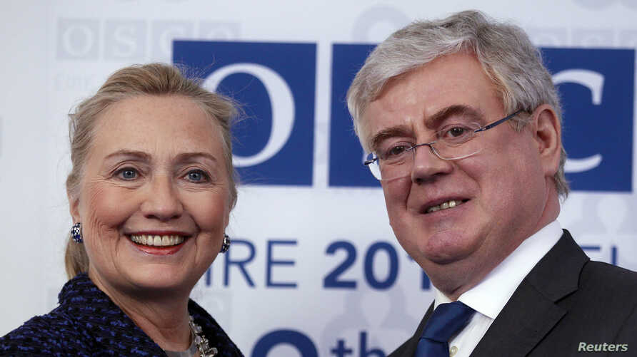 U.S. Secretary of State Hillary Clinton meets Irish Foreign Minister Eamon Gilmore at the Organization for Security and Co-operation in Europe (OSCE) conference opening session in Dublin, December 6, 2012.