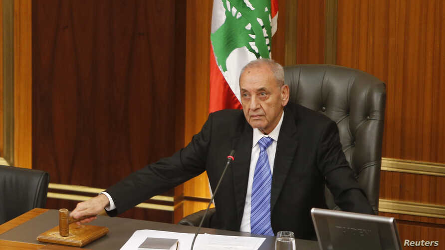 Lebanese Parliament speaker Nabih Berri strikes his gavel at the end of a parliamentary session in parliament in Beirut, May 31, 2013.