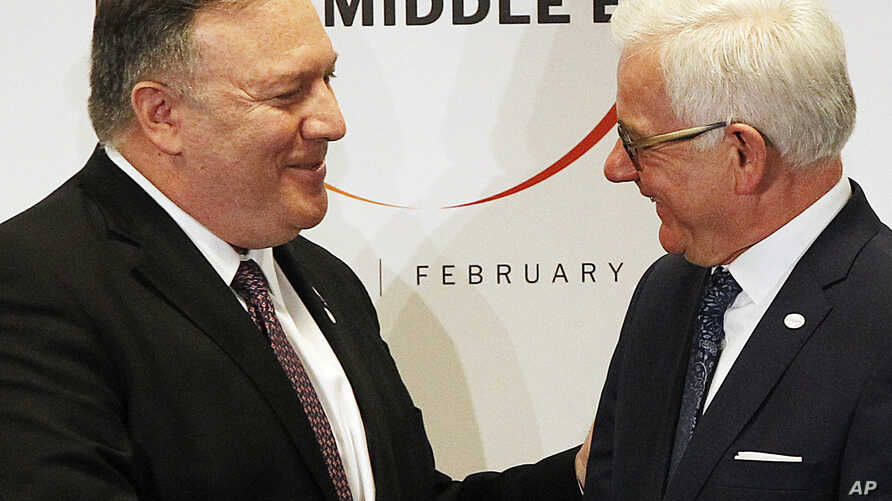 Poland's Minister of Foreign Affairs Jacek Czaputowicz, right and U.S. Secretary of State Mike Pompeo shake hands at the end of a conference on promoting security in the Middle East that Poland co-hosted with the United States, in Warsaw,  Feb. 14, 2