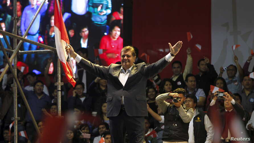 Peru's former president Alan Garcia greets supporters during a meeting in Lima, Oct. 30, 2015.