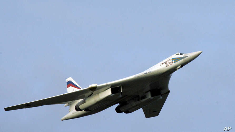 ** FILE ** A supersonic Tu-160 strategic bomber with Russian President Vladimir Putin aboard flies above an airfield near the northern city of Murmansk, in this Tuesday, Aug. 16, 2005, file photo. Two Russian strategic bombers landed in Venezuela on