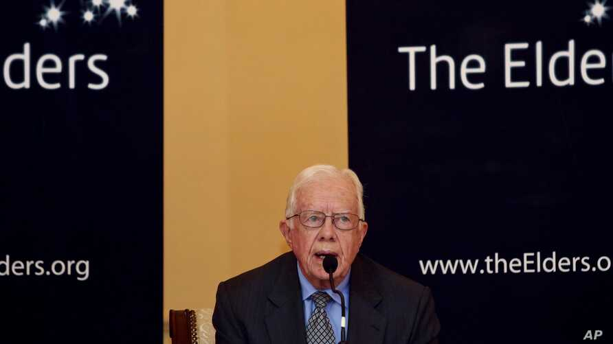 Former U.S. president Jimmy Carter speaks during news conference in Rangoon, Sept. 26, 2013.