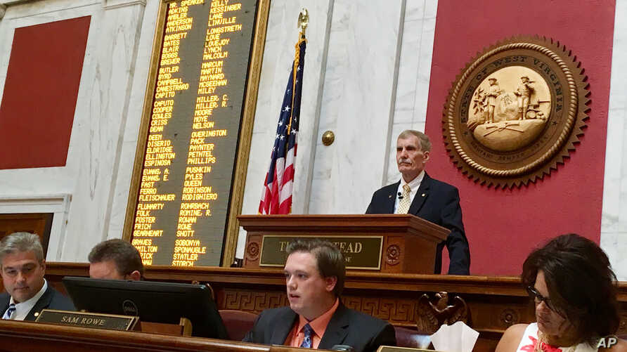 West Virginia House Speaker Pro Tempore John Overington presides over the start of a hearing, Aug. 13, 2018, at the  Capitol in Charleston, W. Va. The House of Delegates was considering the impeachment of the entire state Supreme Court in a scandal o