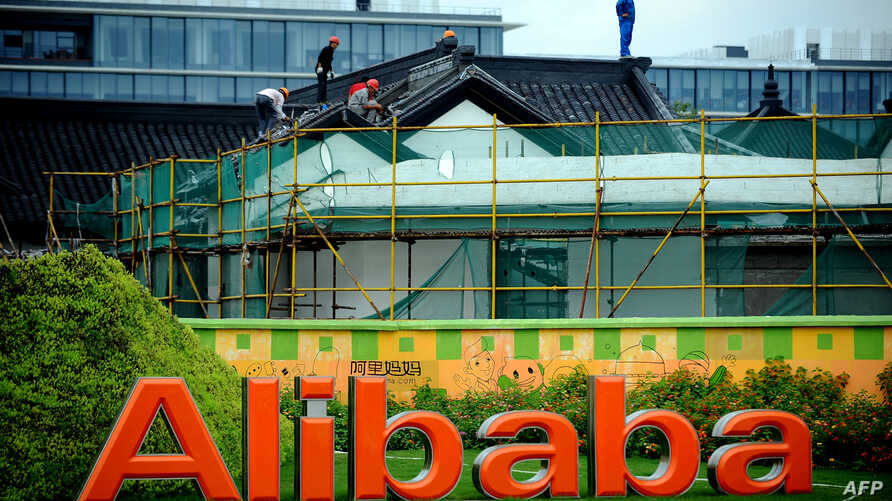 Workers renovate a building at the Alibaba head office in Hangzhou, east China's Zhejiang province, Sept. 15, 2014.
