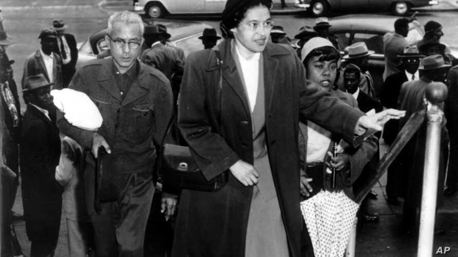 FILE -Rosa Parks arrives at circuit court to be arraigned in the racial bus boycott in Montgomery, Alabama, Feb. 24, 1956.