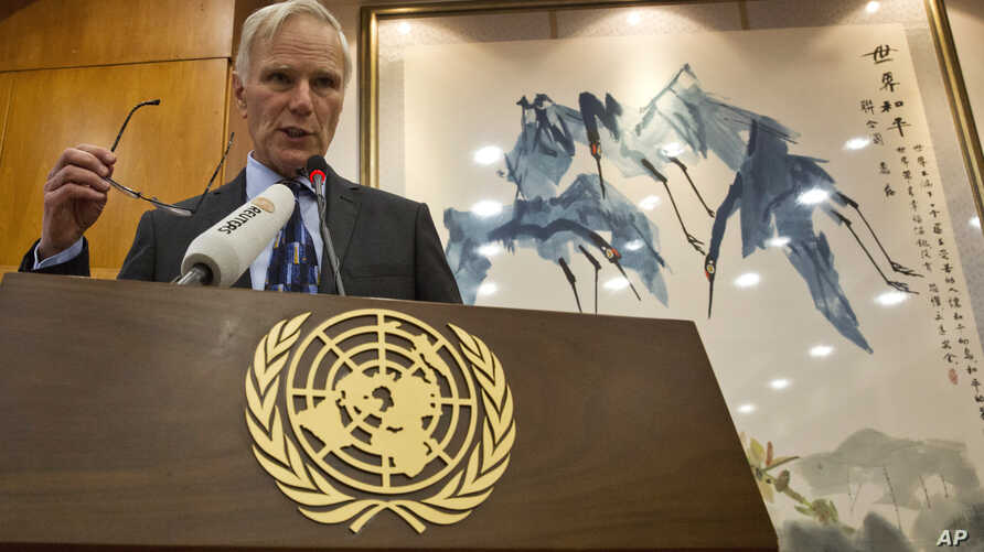 FILE - United Nations Special Rapporteur on extreme poverty and human rights, Philip Alston speaks during a news conference held in Beijing, China,  Aug. 23, 2016.