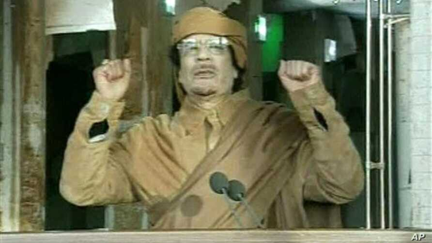 This image broadcast on Libyan state television Feb. 22, 2011, shows Libyan leader Moammar Gadhafi as he addresses the nation in Tripoli