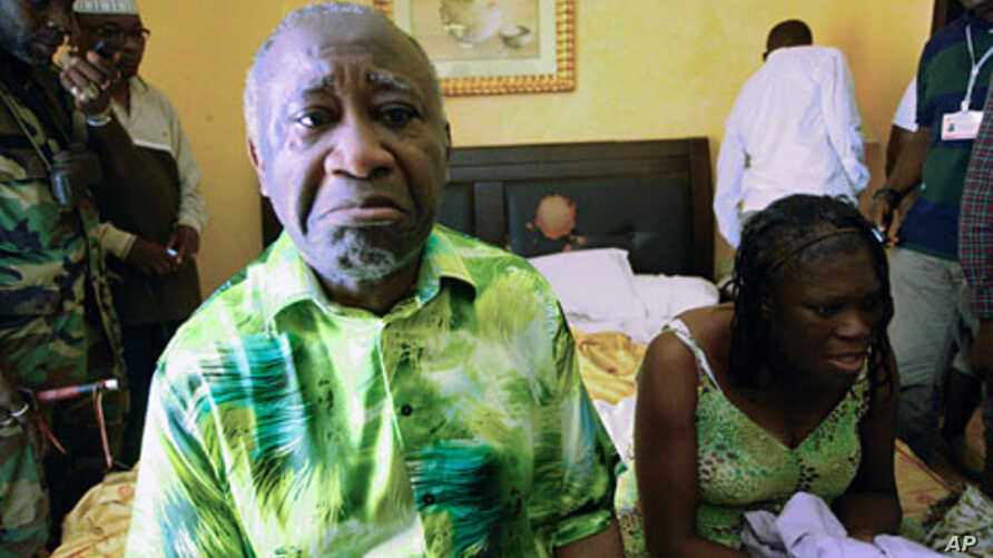 Ivory Coast's Laurent Gbagbo  (L) and his wife Simone sit in a room at Hotel Golf in Abidjan, after they were arrested, Apr 11 2011