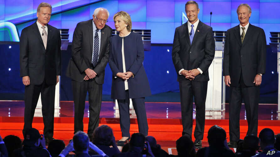 Democratic presidential candidates, from left, former Virginia Sen. Jim Webb, Sen. Bernie Sanders of Vermont, former Secretary of State Hillary Clinton, former Maryland Gov. Martin O'Malley and former Rhode Island Gov. Lincoln Chafee, take the stage