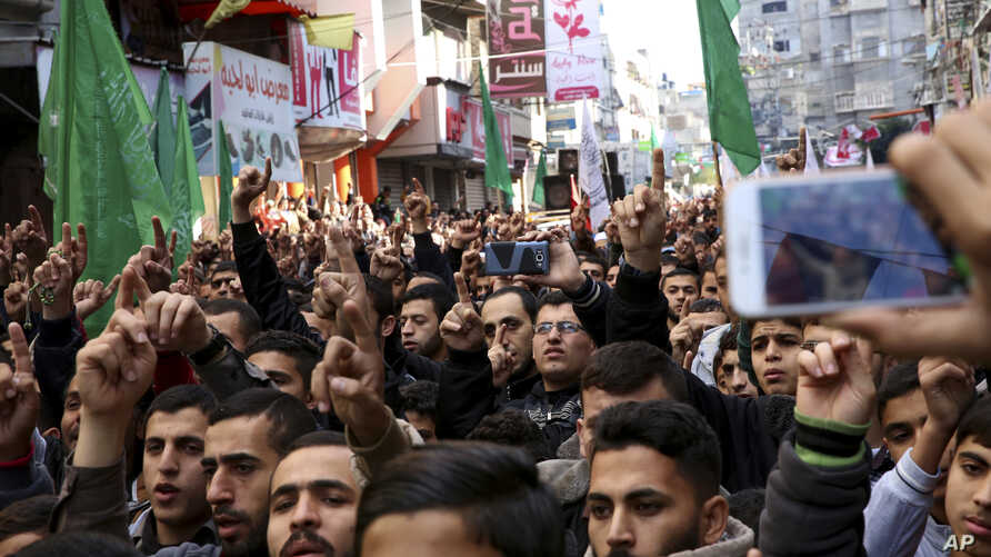 Hamas supporters chant slogans while raising their hands up during protest against President Donald Trump's decision to recognize Jerusalem as Israel's capital, in Jebaliya Refugee Camp, Gaza Strip, Dec. 8, 2017.
