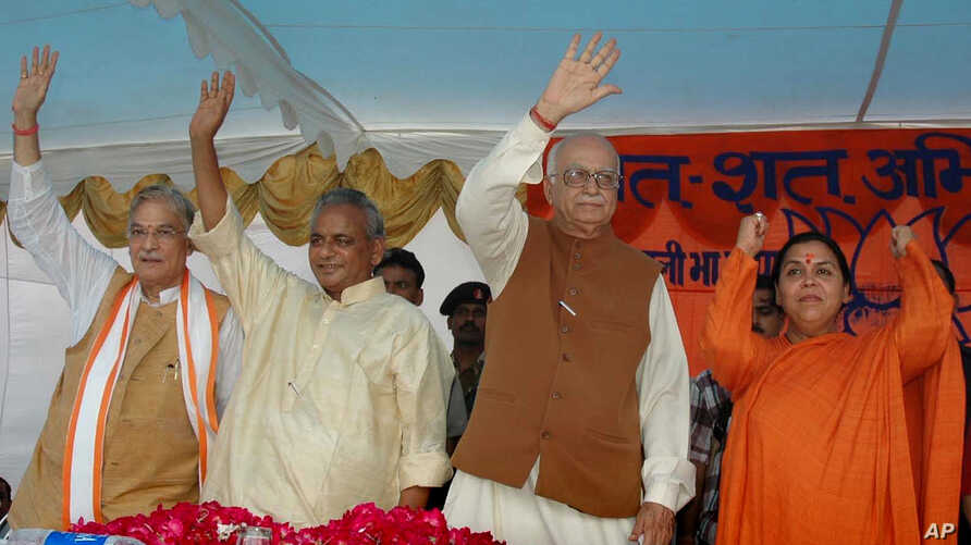 FILE - In this July 28, 2005 photo, President of the Bharatiya Janta Party (BJP) Lal Krishna Advani, second right, senior BJP leaders Uma Bharati, right, Kalyan Singh, second left, and Murli Manohar Joshi wave to people during a public rally in Rae B