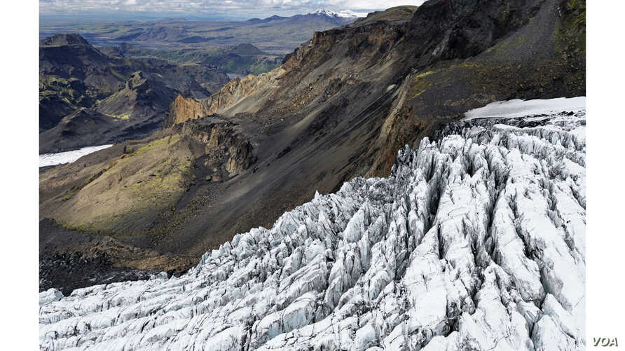 This eroding glacier flows from the Mýrdalsökull ice cap. The distant snowy mountains are remnants of a large volcano that erupted 53,000 years ago. (Feo Pitcairn Fine Art)