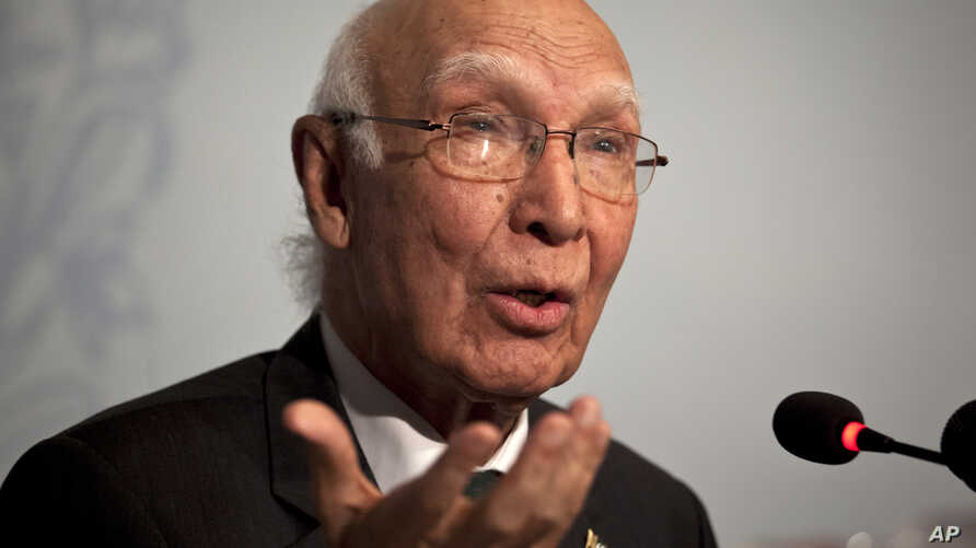 FILE - Pakistan's National Security Adviser Sartaj Aziz gestures during a press conference in Islamabad, Pakistan, Aug. 22, 2015.