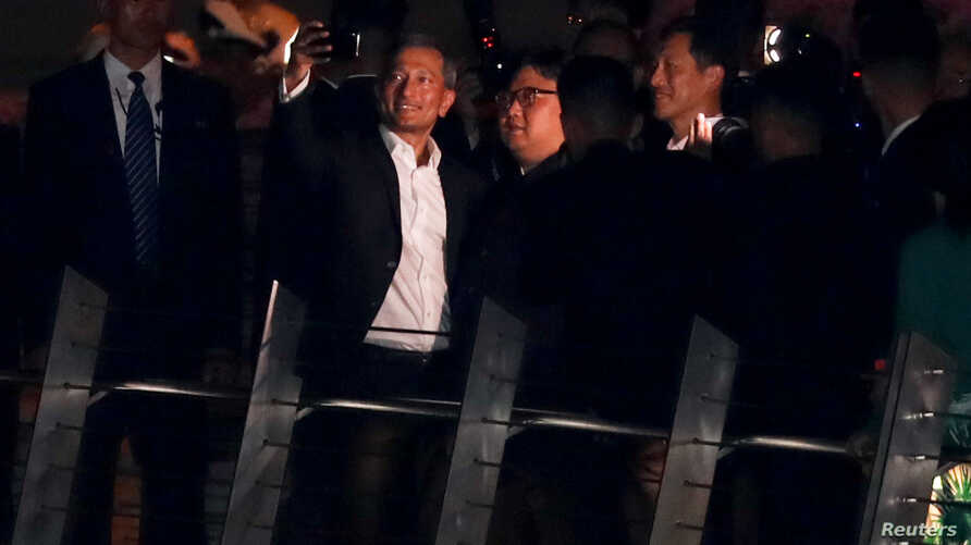 Singapore's Foreign Minister Vivian Balakrishnan takes a selfie with North Korea's leader Kim Jong Un during a visit in Merlion Park in Singapore, June 11, 2018.
