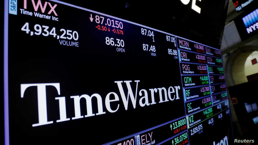 FILE - Time Warner shares are projected on a acreen above the floor of the New York Stock Exchange, New York, U.S.