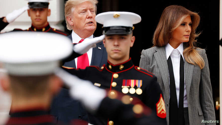 FILE - U.S. President Donald Trump and first lady Melania Trump are seen during an arrival ceremony at the South Portico of the White House in Washington, Oct. 11 2017. Trump will be hosting the leaders of Estonia, Latvia and Lithuania at the White H