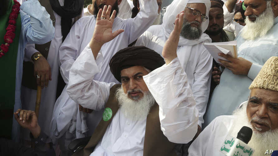 FILE - Khadim Hussain Rizvi, leader of Pakistani religious party Tehreek-i-Labaik waves to his supporters during a march, Aug. 29, 2018, in Lahore, Pakistan.