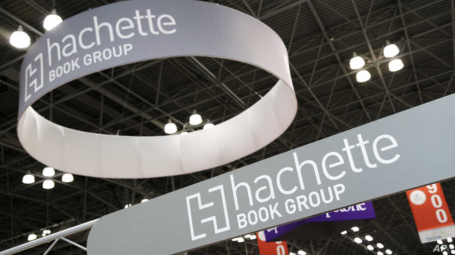 FILE - In this May 28, 2015 file photo, signage for Hachette Book Group are displayed at BookExpo America in New York.
