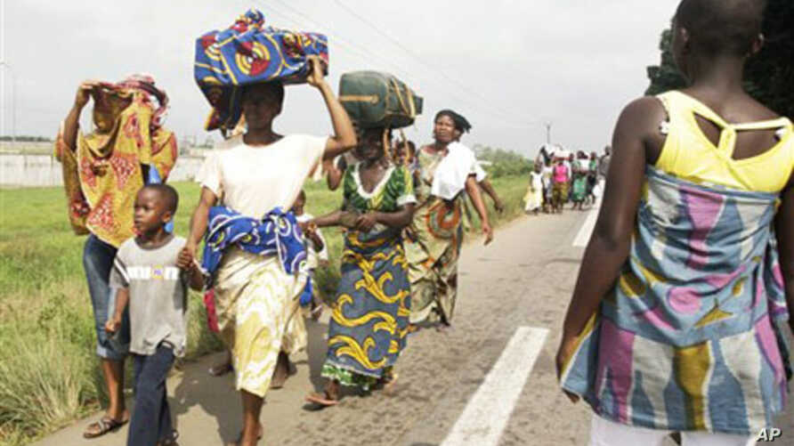 People fearing for their safety evacuate the Abobo district of Abidjan, Ivory Coast, February 24, 2011
