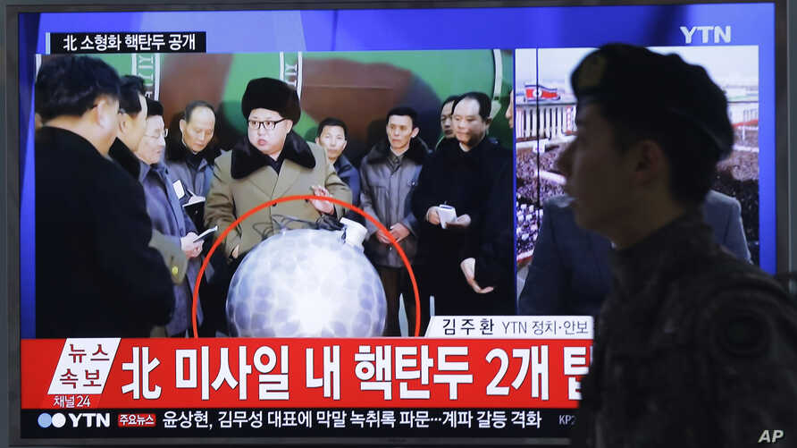 "A South Korean army soldier walks by a TV screen showing North Korean leader Kim Jong Un with superimposed letters that read: ""North Korea's nuclear warhead"" during a news program at Seoul Railway Station in Seoul, South Korea, March 9, 2016."