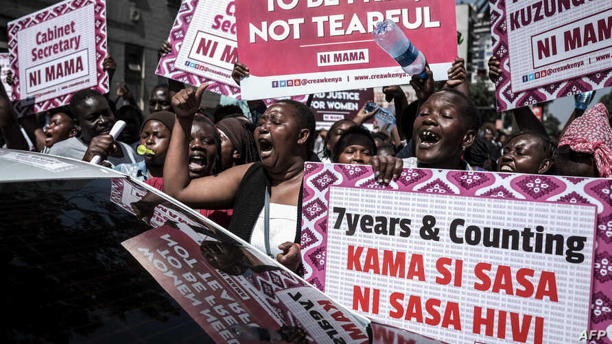 Women hold signs and shout during a protest against repeated failures to apply laws that women must hold at least one-third of government seats in Nairobi, Kenya, Jan. 22, 2018.