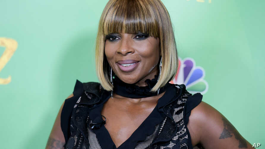 FILE - Mary J. Blige attends 'The Wiz Live!' Photo Op at the Directors Guild of America in Los Angeles, June 1, 2016.