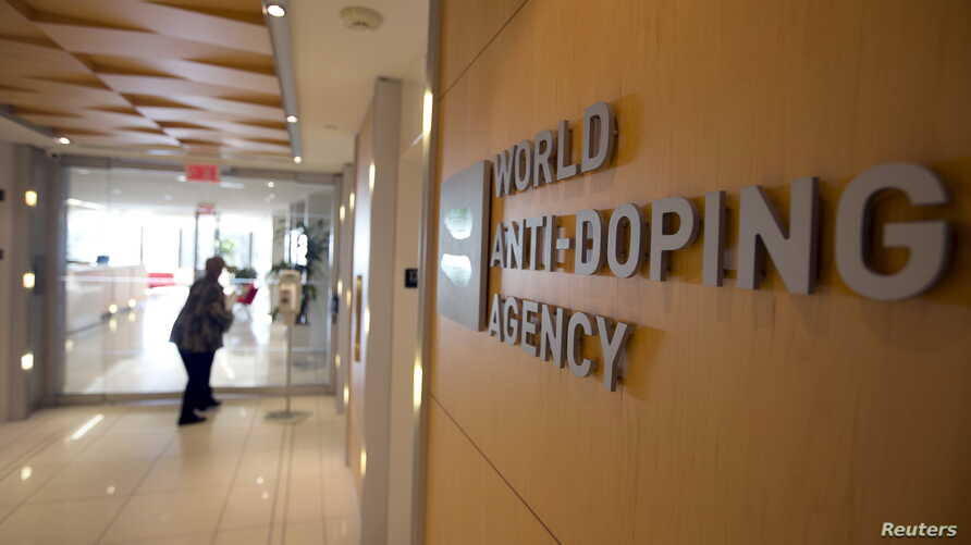 A woman walks into the head office for the World Anti-Doping Agency (WADA) in Montreal, Nov. 9, 2015.