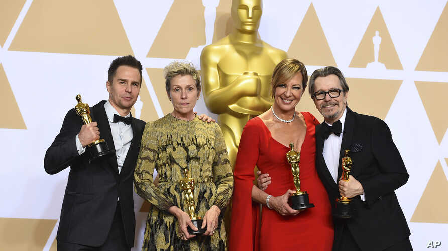 "Sam Rockwell, from left, winner of the award for best performance by an actor in a supporting role for ""Three Billboards Outside Ebbing, Missouri"", Frances McDormand, winner of the award for best performance by an actress in a leading role for ""Three"