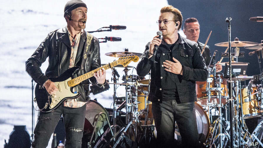 The Edge (left) and Bono of U2 perform at the Bonnaroo Music and Arts Festival, June 9, 2017, in Manchester, Tenn.