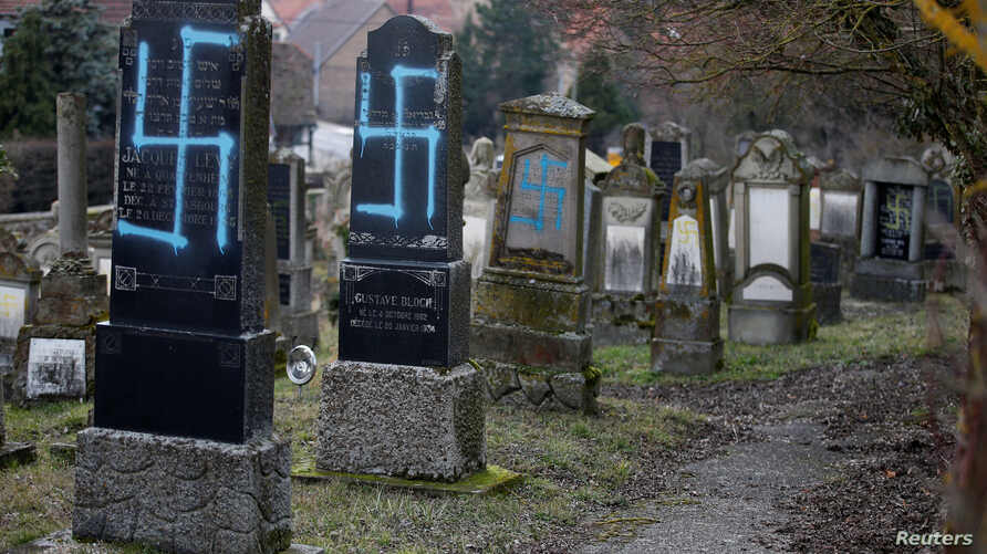Graves desecrated with swastikas are seen in the Jewish cemetery in Quatzenheim, near Strasbourg, Feb. 19, 2019.