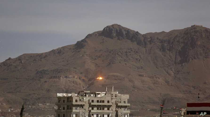 FILE - An explosion is seen following a Saudi-led airstrike in Sana'a, Yemen, Sept. 24, 2015.