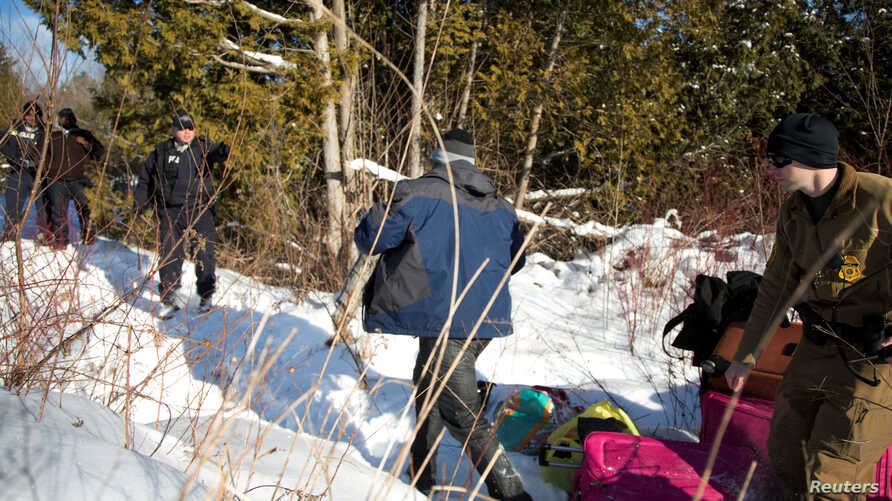 A man who claimed to be from Sudan runs for the border after his family crossed the U.S.-Canada border into Hemmingford, Canada, from Champlain, New York, Feb. 17, 2017.