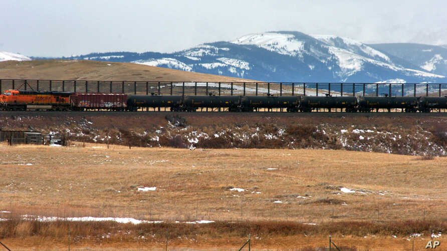 FILE - A train hauls oil into Glacier National Park near the Badger-Two Medicine National Forest in northwest Montana. U.S. Interior Secretary Ryan Zinke appears to be carving out an exception for his home state from the Trump administration's agenda