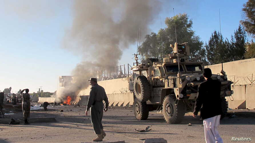 Smoke bellows after a suicide car bomb blast attacked a military convoy in Lashkar Gah, Helmand province, Afghanistan, Nov. 15, 2015.