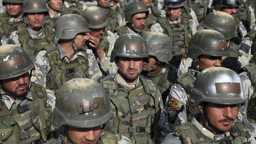 FILE - Afghan special police forces attend their graduation ceremony at a special forces training center in Kabul, Feb. 22, 2018.