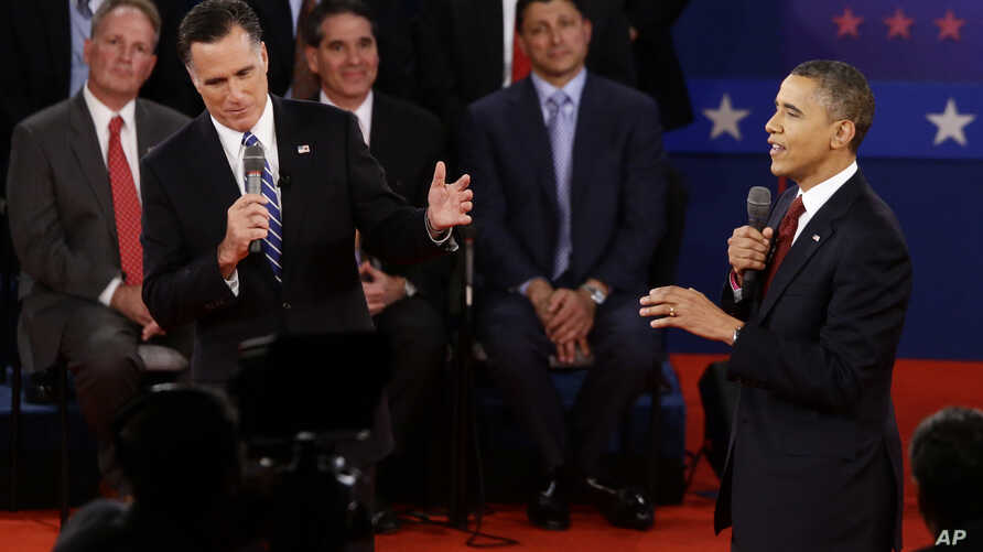 President Barack Obama and Republican presidential candidate and former Massachusetts Gov. Mitt Romney participate in the second presidential debate at Hofstra University in Hempstead, N.Y., Tuesday, Oct. 16, 2012.