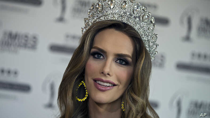 Angela Ponce, who won Spain's Miss Universe competition in June, speaks during an interview with The Associated Press in Madrid, Spain, July 10, 2018.