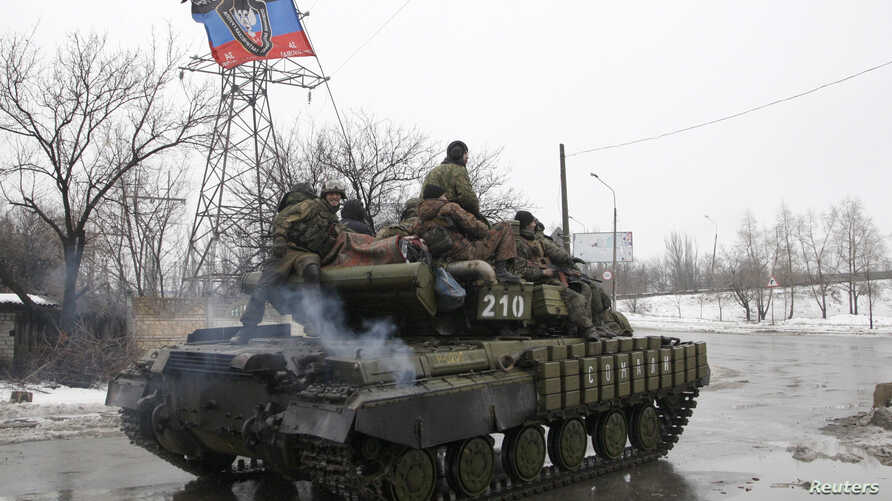 Members of the armed forces of the separatist self-proclaimed Donetsk People's Republic drive an armored vehicle on the outskirts of Donetsk Jan. 22, 2015.