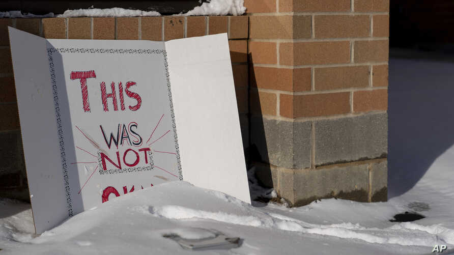 """A sign reading """"This was not okay,"""" is seen in front of Covington Catholic High School in Park Kills, Ky., Jan 20, 2019."""