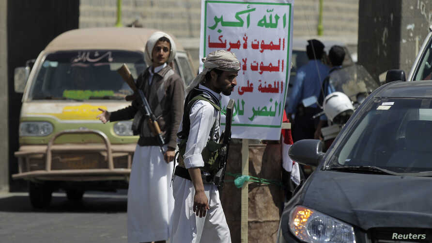 Shi'ite Houthi rebels man a checkpoint in Sana'a, Yemen, Sept. 24, 2014.