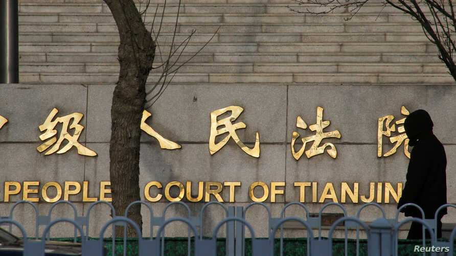 A man walks past the courthouse where prominent rights lawyer Wang Quanzhang is being tried in Tianjin, China December 26, 2018.