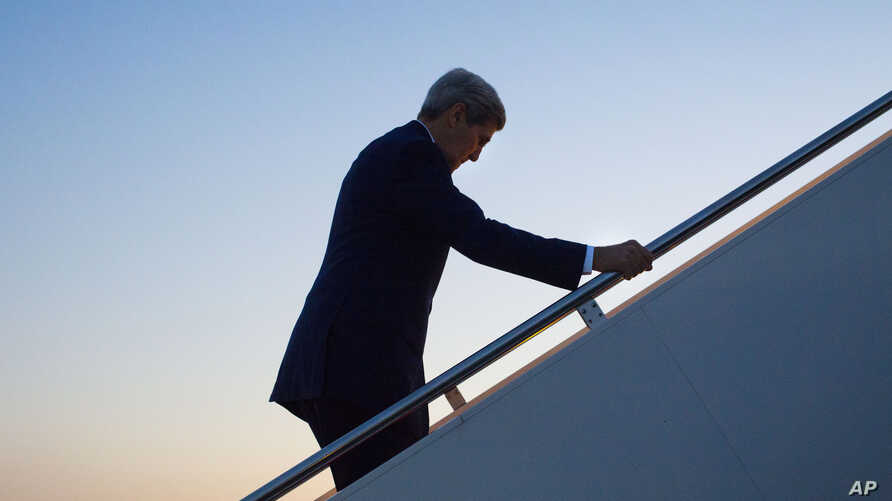 FILE - Secretary of State John Kerry walks up the stairs to board his aircraft at Andrews Air Force Base, Maryland, Aug. 14, 2015.