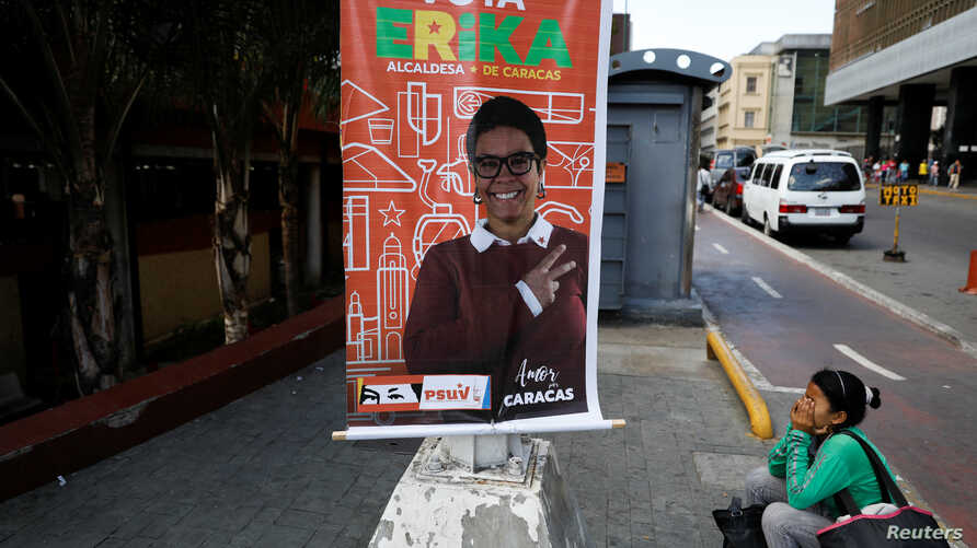 Campaign posters for Erika Farias, a pro-government candidate for mayor of Caracas' Libertador district, hang in the Venezuelan capital. Venezuelans vote Sunday on 335 open mayoral seats.