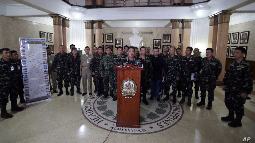 Philippine military chief Gen. Gregorio Pio Catapang, center, talks to reporters about the situation of Filipino peacekeepers in Golan Heights during a press conference at Camp Aguinaldo military headquarters in suburban Quezon city, Philippines, Aug