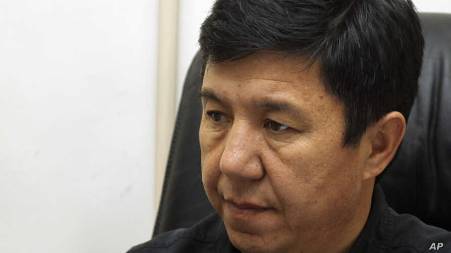 Former Kyrgyz Finance Minister and Ak-Shumkar leader Temir Sariyev listens to a question during his interview with the Associated Press in Bishkek, Kyrgyzstan, Oct. 7, 2010.