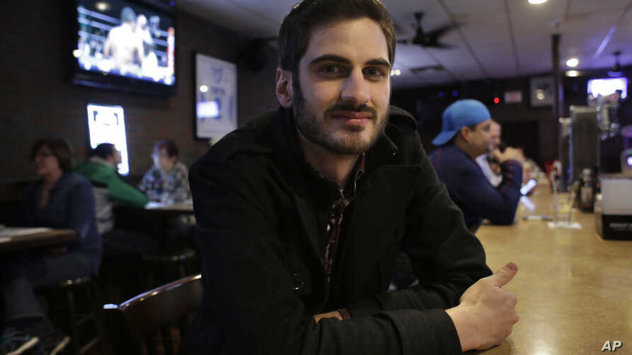 Matt Garlock, of Mansfield, Mass., poses for a photo in a bar in Somerville, Mass. The 29-year old has trouble making out what his friends say in loud bars, but when he got a hearing test, the result was normal, Feb. 22, 2017..