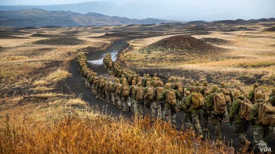 U.S. Marines with the 24th Marine Expeditionary Unit hike to a cold-weather training site inland, Iceland, Oct. 19, 2018, during Exercise Trident Juncture 18.